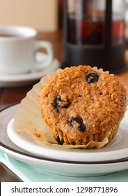A healthier muffin for your morning breakfast, baked with canola oil, fresh blueberries and unprocessed wheat bran