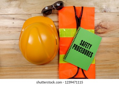HEALTH,SAFETY & ENVIRONMENT CONCEPTUAL with general texts and standard construction safety equipment