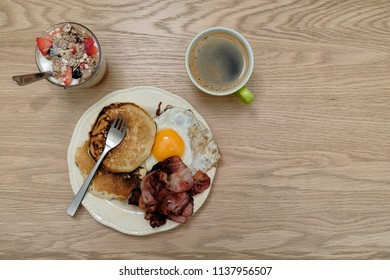 Healthy american breakfast shot from top down with black coffee on wood counter