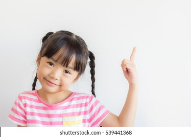 healthy asian child point at the blank