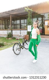 healthy asian female stand on garden, she will exercise with bicycle, she feeling happy and confident, adult health promotion