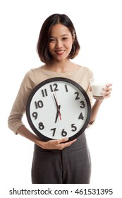 Healthy Asian woman drinking  glass of milk hold clock  isolated on white background .