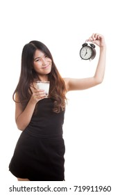 Healthy Asian woman drinking  glass of milk hold clock isolated on white background