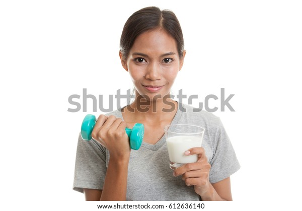 Healthy Asian woman drinking a glass of milk and dumbbell  isolated on white background.
