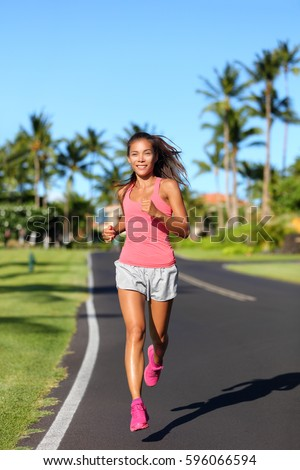 c3064f71a2fa Healthy Asian woman runner jogging on urban road. Fitness girl athlete  working out living an active lifestyle training cardio in the morning  running in pink ...