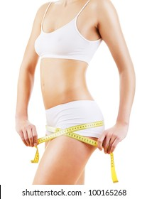 healthy attractive body with tapemeasure on white background