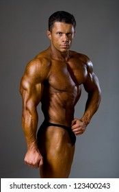 healthy attractive guy showing his strong and fit torso