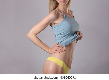 Healthy attractive, shape ,woman body, waistline. Slim female torso, waist, perfect abdomen muscles close up. Sport, fitness, Dieting results,laser lipolysis, active lifestyle concept