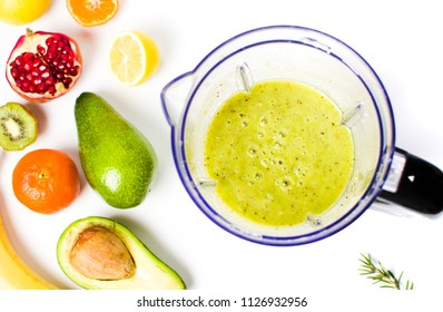 Healthy avocado smoothie in a blender with various fruits