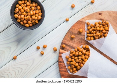 Healthy baked spiced chickpeas with a variety of spices, a high-protein fit snack.