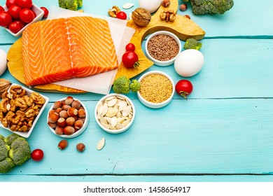 Healthy balanced low carbs food with healthy fats. Ketogenic diet concept. Nutrition for the heart and blood vessels. Fresh organic ingredients, turquoise wooden boards background, copy space