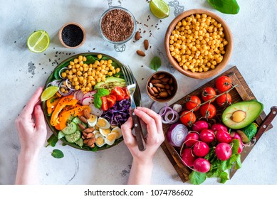Healthy balanced vegetarian food concept, buddha bowl salad. Avocado, spinach, chick peas, vegetable appetizer plate
