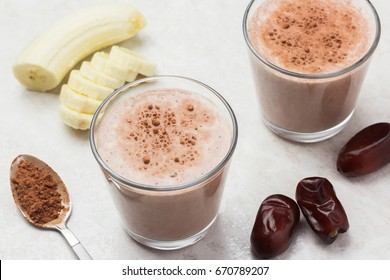 Healthy banana dates milk shake and ingredients. Delicious breakfast.