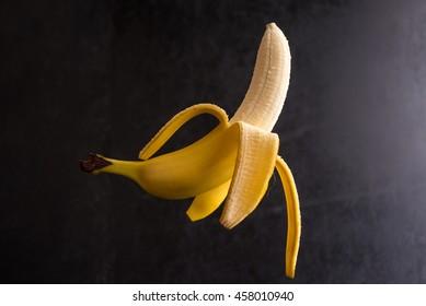 Healthy banana isolated on black background