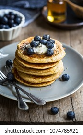 Healthy Banana Oat Pancakes with Blueberries, Coconut cream and Chia topping