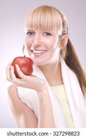 Healthy beautiful blonde holding a red apple