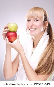 Healthy beautiful blonde holding two apples