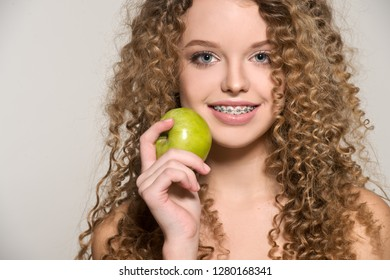 Healthy, beautiful smile, cute teen  with dental braces smiling . Portrait of a girl with orthodontic appliance.