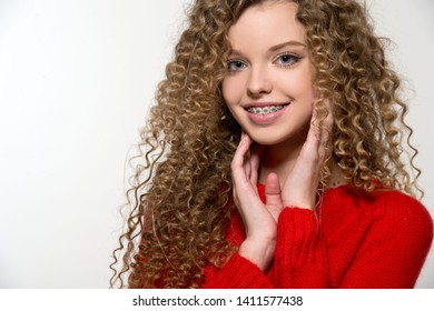 Healthy, beautiful smile, cute teen  with dental braces smiling . Portrait of a girl with orthodontic appliance.  Curly haired girl.