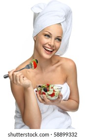 Healthy beauty Beautiful blonde girl in towel eating fresh salad and smiling