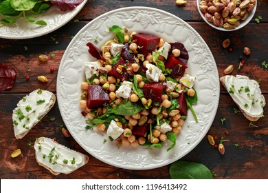 Healthy Beet Salad with chickpeas, pistachios nuts, feta and melted cheese toast