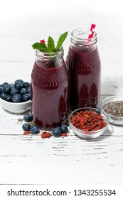 healthy berry smoothies with chia seeds and goji berries, vertical, closeup