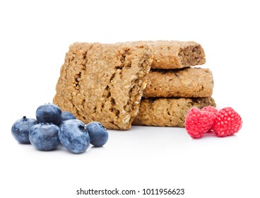 Healthy bio breakfast biscuits with blueberries and raspberries on white background