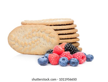 Healthy bio breakfast biscuits with blueberries and raspberries and blackberries on white background