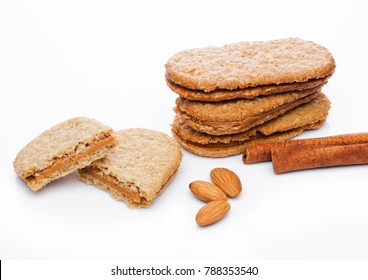Healthy bio breakfast grain biscuits with almonds and cinnamon on white background