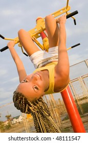 Healthy blond female model exercising on outdoor playground