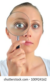 Healthy blondy happy woman looking with a magnifying glass
