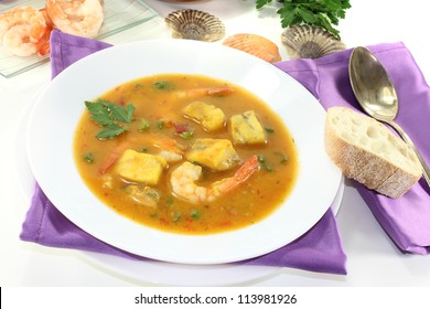 healthy bouillabaisse with seafood and parsley on a bright background