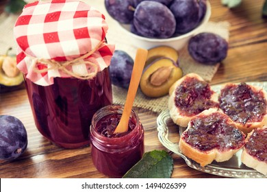 Healthy bread with fresh plum jam and plums cutting. Homemade delicious breakfast