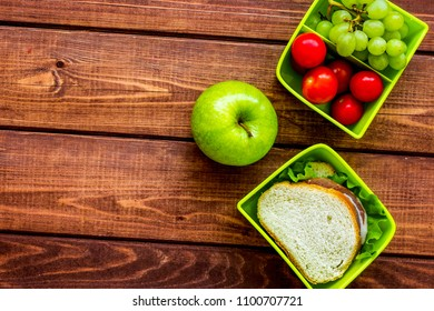 healthy break with apple, grape and sandwich in lunchbox on home