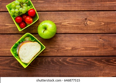 healthy break with apple, grape and sandwich in lunchbox on home table flat lay mock-up