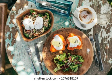 Healthy breakfast. Avocado toasts with salmon and poached eggs