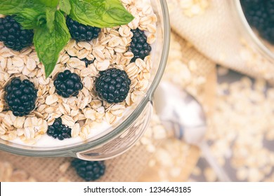 Healthy breakfast with bowl of cereal musli and blackberries