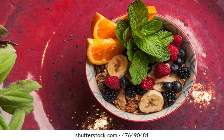 Healthy breakfast  bowl topped with  berries,raspberry, banana and oats. healthy food