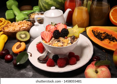 Healthy breakfast. Bowl of yogurt with granola and berries, fresh fruits and smootihies