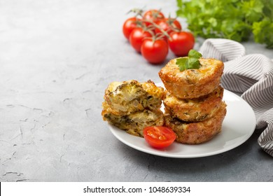 healthy breakfast. broccoli cheese bites (muffins) on gray concrete background