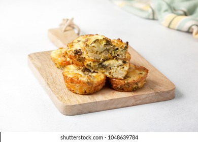 healthy breakfast. broccoli cheese bites (muffins) on light concrete background