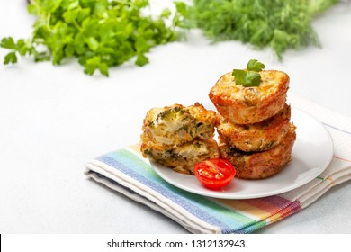 healthy breakfast. broccoli cheese bites (muffins), fresh tomatoes, fresh herbs on light concrete background. snack for keto diet