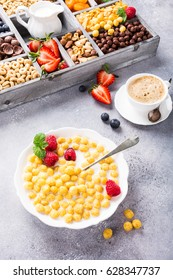 Healthy breakfast with cereal balls, fresh milk and berries, selective focus.