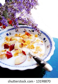 healthy breakfast cereals with fruits isolated with flowers