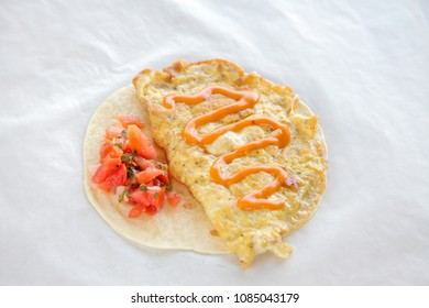 Healthy breakfast cheese omelette on tortilla wrap