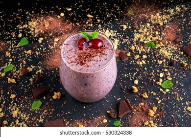 Healthy Breakfast Chocolate, berry and oats Smoothie decorated with cherry