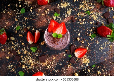 Healthy Breakfast Chocolate, berry and oats Smoothie decorated with strawberry