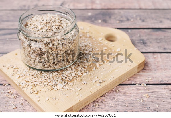 Healthy breakfast concept with oatmeal on a wooden background