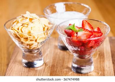 Healthy breakfast. Cornflakes, fresh strawberry and yogurt