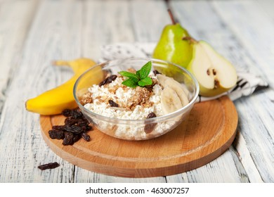A healthy breakfast cottage cheese with Granola and fruit